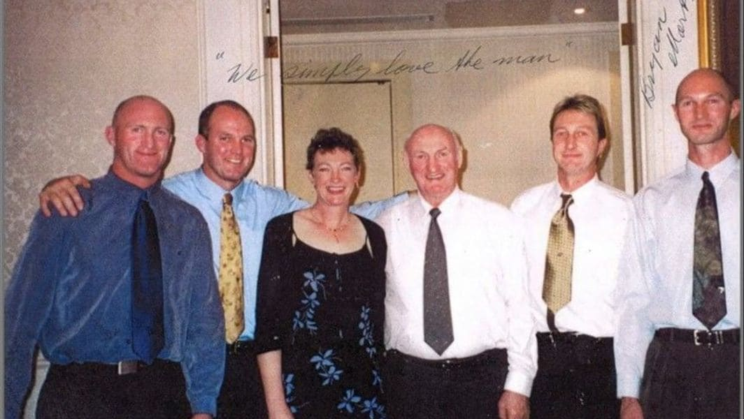 The Martyn siblings, pictured with their uncle Kevin O'Brien in Melbourne, on the occasion of Kevin's 70th birthday in 2002 – from left to right Michael, Stephen, Rosemary, Kevin O'Brien, Peter and John. Caption penned across the top of the photograph reads: 'We simply love the man.'